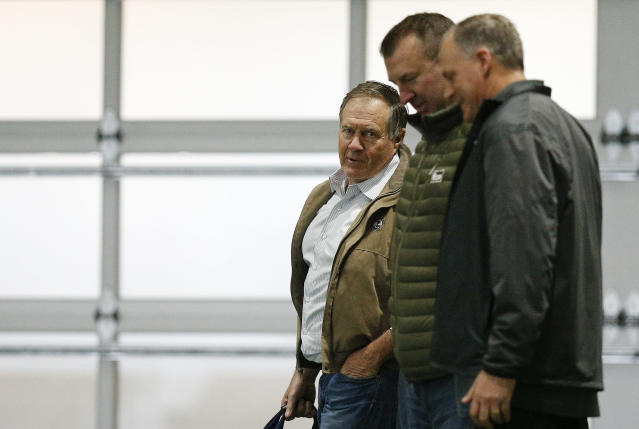 New England Patriots coach Bill Belichick, left, and former Arkansas coach Bret Bielema, center, walk the field during Alabama's Pro Day, Wednesday, March 7, 2018, in Tuscaloosa, Ala. The event is to showcase players for the upcoming NFL football draft. (AP Photo/Brynn Anderson)