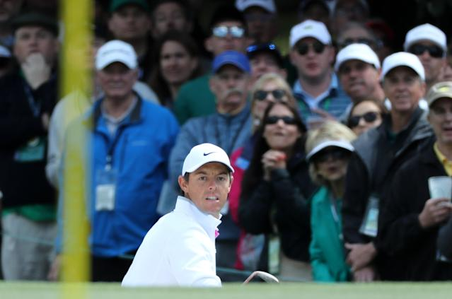 Rory McIlroy of Northern Ireland watches his chip onto the first green during final round play of the 2018 Masters golf tournament at the Augusta National Golf Club in Augusta, Georgia, U.S. April 8, 2018. REUTERS/Lucy Nicholson