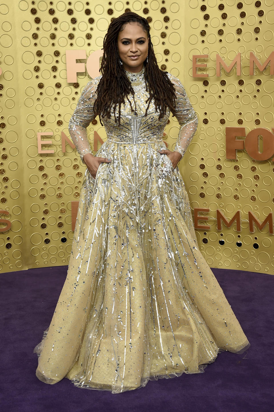 "FILE - Ava DuVernay arrives at the 71st Primetime Emmy Awards in Los Angeles on Sept. 22, 2019. DuVernay, who created the TV series ""Queen Sugar"" hired Cierra Glaude to work on the Oscar-nominated 2014 film ""Selma"" as well as her CBS pilot ""For Justice."" (Photo by Jordan Strauss/Invision/AP, File)"
