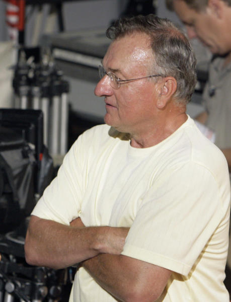 """FILE - In this June 15, 2007, file photo, Ed Rush talks to the actor portraying him in """"Our Lady of Victory,"""" on the set of the movie in West Chester, Pa. Rush has resigned as the Pac-12 Conference's coordinator of officials following comments that he targeted Arizona coach Sean Miller during internal meetings before the conference tournament. Pac-12 Commissioner Larry Scott said in a statement released Thursday, April 4, 2013, that """"I want to express my appreciation for the great contribution Ed made to basketball officiating for the Conference during his tenure, particularly in the area of training and the cultivation of new officiating talent."""" (AP Photo/Matt Rourke, File)"""