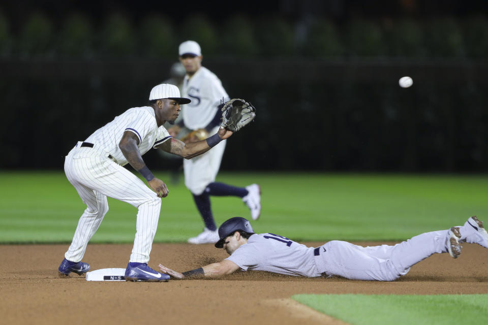 Tim Anderson #7 of the Chicago White Sox looks for the ball as Tyler Wade #14 of the New York Yankees