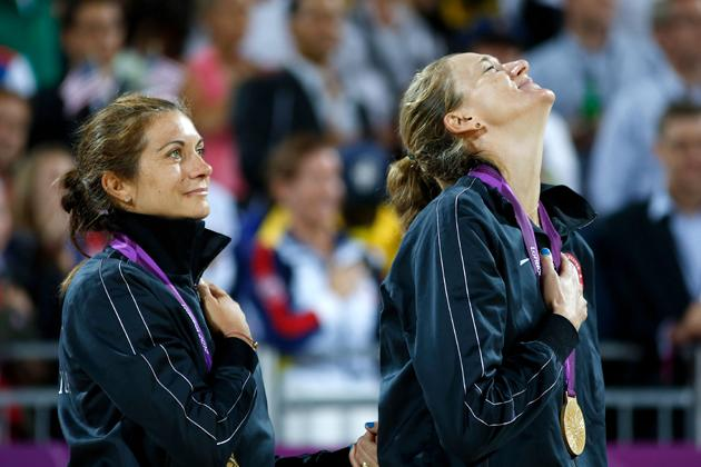 LONDON, ENGLAND - AUGUST 08:  Gold medallists Misty May-Treanor and Kerri Walsh Jennings celebrate on the podium during the medal ceremony for the Women's Beach Volleyball on Day 12 of the London 2012 Olympic Games at the Horse Guard's Parade on August 8, 2012 in London, England.  (Photo by Jamie Squire/Getty Images)