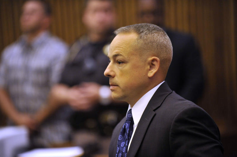 "Detroit police officer Joseph Weekley stands in Judge Cynthia Hathaway's courtroom at the Frank Murphy Hall of Justice in Detroit, Michigan on Tuesday, June 18, 2013 as the judge instructs jurors to continue to work toward a verdict after they sent her a note saying they are ""stuck"". The judge declared a mistrial Tuesday after jurors failed to reach a verdict in the trial. Weekley is charged with involuntary manslaughter in the shooting death of 7-year-old Aiyana Stanley-Jones. (AP Photo/The Detroit News, John T. Greilick) DETROIT FREE PRESS OUT; HUFFINGTON POST OUT"
