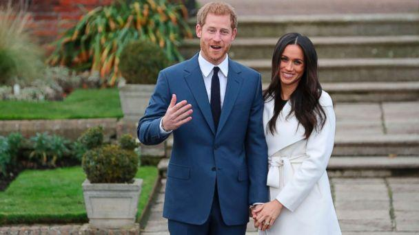 PHOTO: Britain's Prince Harry and his fiance U.S. actress Meghan Markle pose for a photograph in the Sunken Garden at Kensington Palace in west London, Nov. 27, 2017, following the announcement of their engagement.<p>(Daniel Leal-Olivas/AFP/Getty Images)