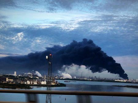 Handout photo of smoke rising from a fire burning at the Intercontinental Terminals Company in Deer Park, east of Houston