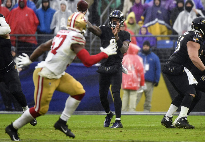 BALTIMORE, MD - DECEMBER 01: Baltimore Ravens quarterback Lamar Jackson (8) throws a pass against the defense of the San Francisco 49ers on December 1, 2019, at M&T Bank Stadium in Baltimore, MD. (Photo by Mark Goldman/Icon Sportswire via Getty Images)
