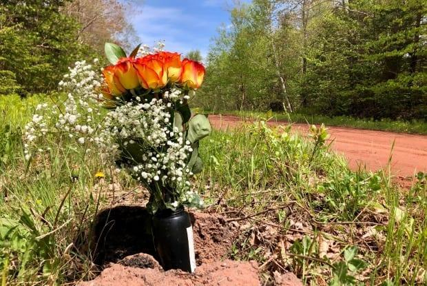 A bouquet of roses has been placed at the side of the road where Austin Keough died while riding an ATV Monday.