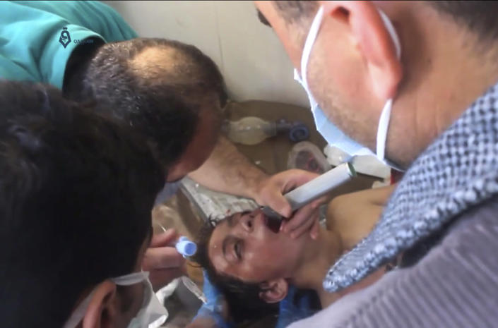 <p>This frame grab from video provided on Tuesday April 4, 2017, by Qasioun News Agency, that is consistent with independent AP reporting, shows a Syrian doctor treating a boy following a suspected chemical attack, in the town of Khan Sheikhoun, northern Idlib province, Syria. The suspected chemical attack killed dozens of people on Tuesday, Syrian opposition activists said, describing the attack as among the worst in the country's six-year civil war. (Qasioun News Agency, via AP) </p>