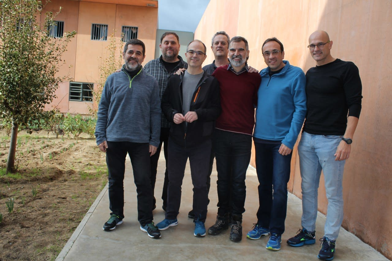 In this undated photo provided by Catalan language association Omnium Cultural, showing jailed Catalan separatist leaders posing for a photo inside Lledoners jail in Sant Joan de Vilatorrada, 50 kms from Barcelona, Spain, with left to right; Jordi Sanchez, Oriol Junqueras, Jordi Turull, Joaquim Forn, Jordi Cuixart, Josep Rull and Raul Romeva. Jordi Sanchez and Jordi Turull, have been in a medical ward since Friday Dec. 14, 2018, as the hunger strike by the group of Catalan politicians enters its third week and begins to take a toll on their health, but they say their upcoming treason trial will allow them to peacefully promote their cause for independence from Spain. (Maria Vernet/Omnium Cultural via AP)