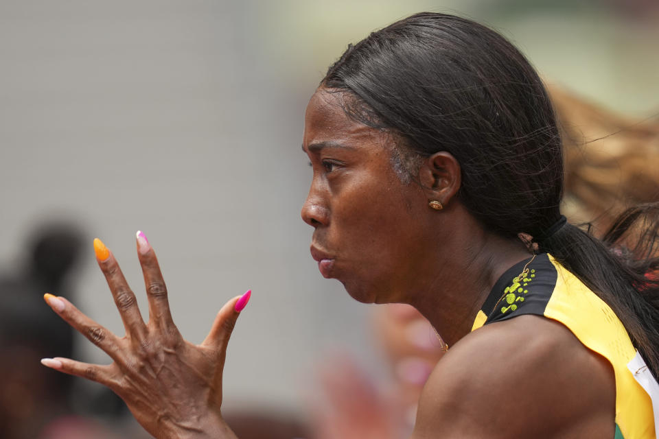 Shelly-Ann Fraser-Pryce, of Jamaica, runs in her heat of the women's 100-meters at the 2020 Summer Olympics, Friday, July 30, 2021, in Tokyo. (AP Photo/Matthias Schrader)