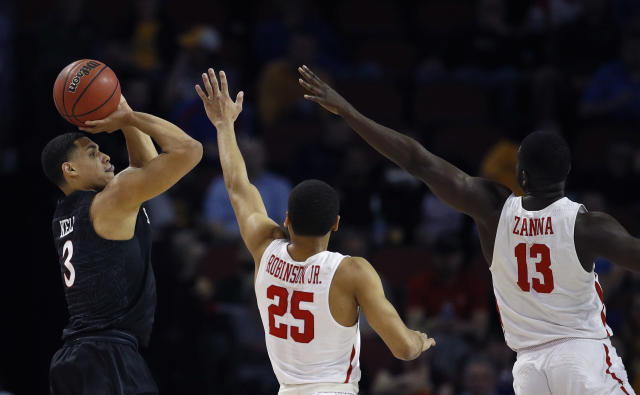 San Diego State guard Trey Kell (3) shoots over Houston guard Galen Robinson Jr. (25) and forward Nura Zanna (13) during the first half of an NCAA men's college basketball tournament first-round game Thursday, March 15, 2018, in Wichita, Kan. (AP Photo/Charlie Riedel)