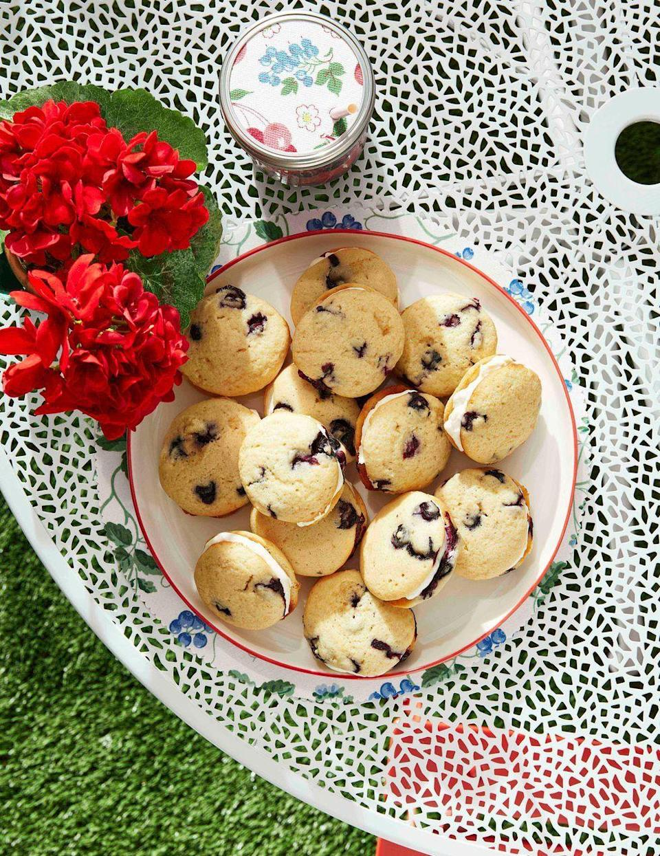 """<p>Soft cookies filled with the seasons ripest blueberries get sandwiched with a tangy mascarpone filling. </p><p><strong><a href=""""https://www.countryliving.com/food-drinks/a32352585/blueberry-whoopie-pies/"""" rel=""""nofollow noopener"""" target=""""_blank"""" data-ylk=""""slk:Get the recipe"""" class=""""link rapid-noclick-resp"""">Get the recipe</a>.</strong> </p>"""