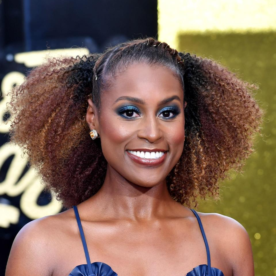 """The two-tone contrast of <a href=""""https://www.allure.com/story/issa-rae-covergirl-interview?mbid=synd_yahoo_rss"""" rel=""""nofollow noopener"""" target=""""_blank"""" data-ylk=""""slk:Issa Rae"""" class=""""link rapid-noclick-resp"""">Issa Rae</a>'s amber and soft copper highlights is simply stunning. """"The combination of highs and lows adds a lot of impact to her curls but still makes her [hair] appear lighter all over,"""" says Bodt. """"When lifting curly or highly-textured hair, it's so important to use products that help the curl pattern come back. I love the whole <a href=""""https://shop-links.co/1700788103436219827"""" rel=""""nofollow noopener"""" target=""""_blank"""" data-ylk=""""slk:Olaplex"""" class=""""link rapid-noclick-resp"""">Olaplex</a> line because it's reparative — from the steps that get added to the color to the after-care."""""""