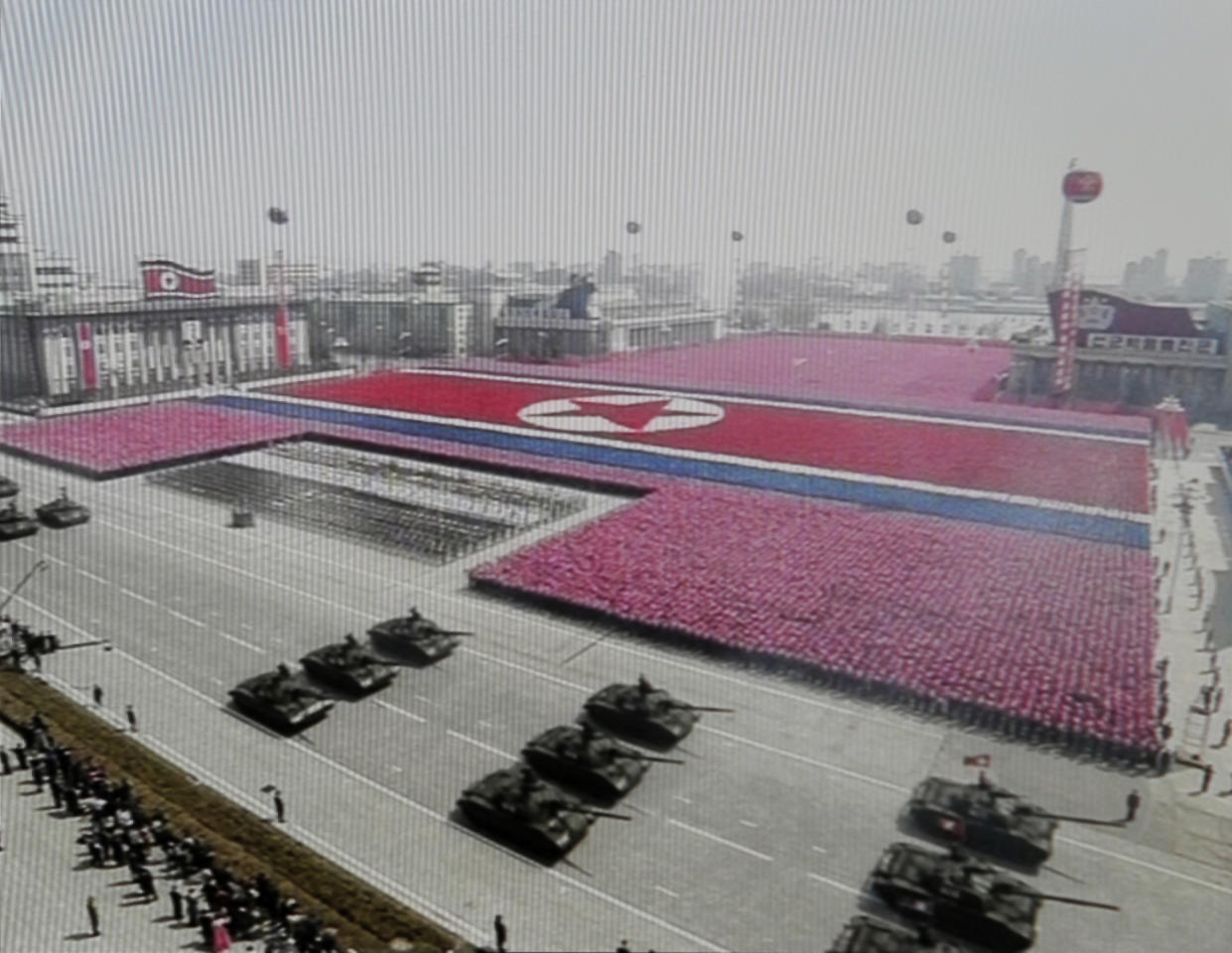 "In this image made from KRT video, North Korean military soldiers participate in a massive celebration marking the 100th birthday of national founder Kim Il Sung, Sunday, April 15, 2012, at Kim Il Sung square in Pyongyang, North Korea. North Korean leader Kim Jong Un spoke publicly for the first time Sunday, just two days after a failed rocket launch, praising his father Kim Jong Il's ""military first"" policy during the celebrations.(AP Photo/KRT via AP video) NORTH KOREA OUT, TV OUT"