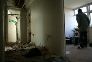 Man looking at half built, abandoned room
