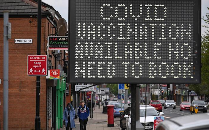 A sign in Bolton, Lancashire, which has seen a rise in Indian variant cases, offers people a Covid jab without the need to make an appointment - Oli Scarff/AFP via Getty Images