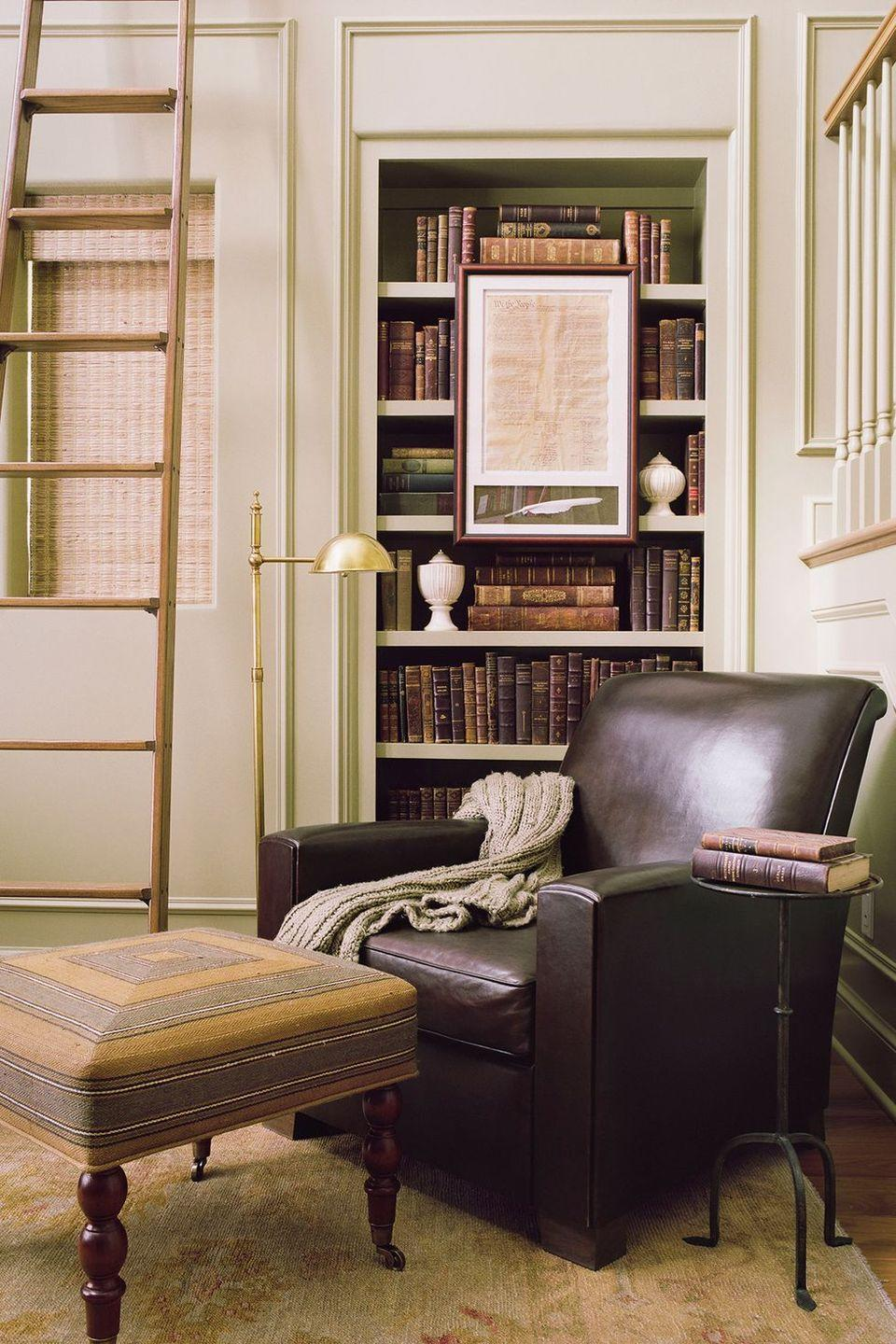 <p>Play up your love of all things traditional with a timeless look, complete with an upholstered leather chair and built-in bookshelves.</p>