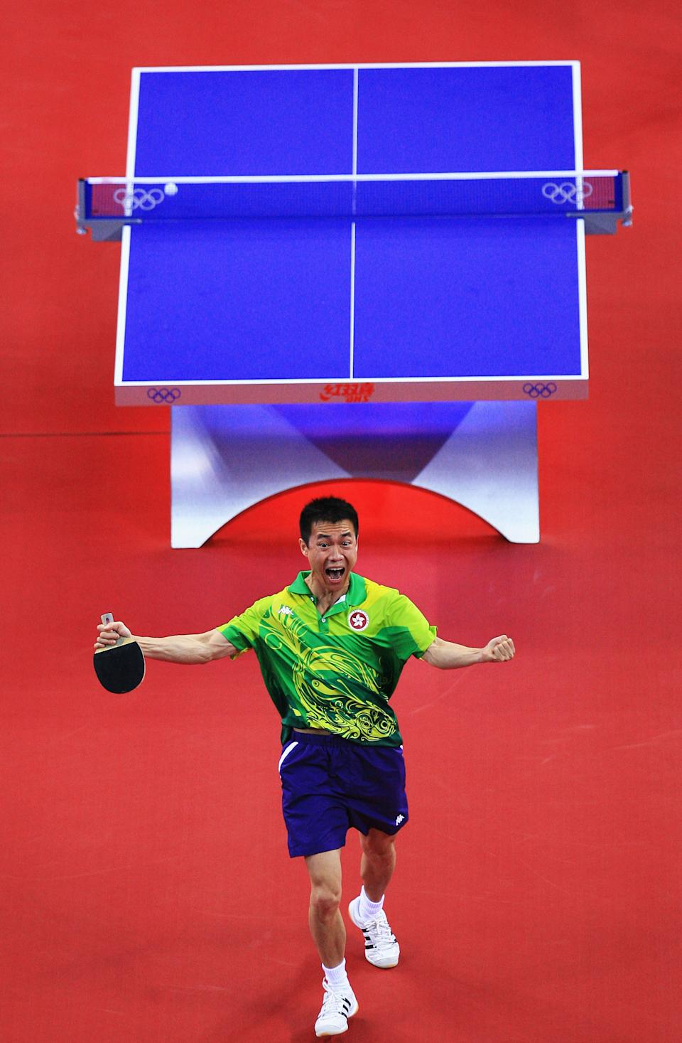 BEIJING - AUGUST 15: Li Ching of Hong Kong China celebrates after defeating Chiang Peng-Lung of Chinese Taipei during a Men's Team Bronze Play-off Round 1 match at the Peking University Gymnasium on Day 7 of the Beijing 2008 Olympic Games on August 15, 2008 in Beijing, China. (Photo by Jamie Squire/Getty Images)