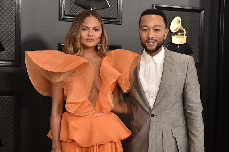 John Legend (pictured with wife Chrissy Teigen) is defending remarks he made about President Trump in a new Cosmopolitan interview. (Photo: David Crotty/Patrick McMullan via Getty Images)