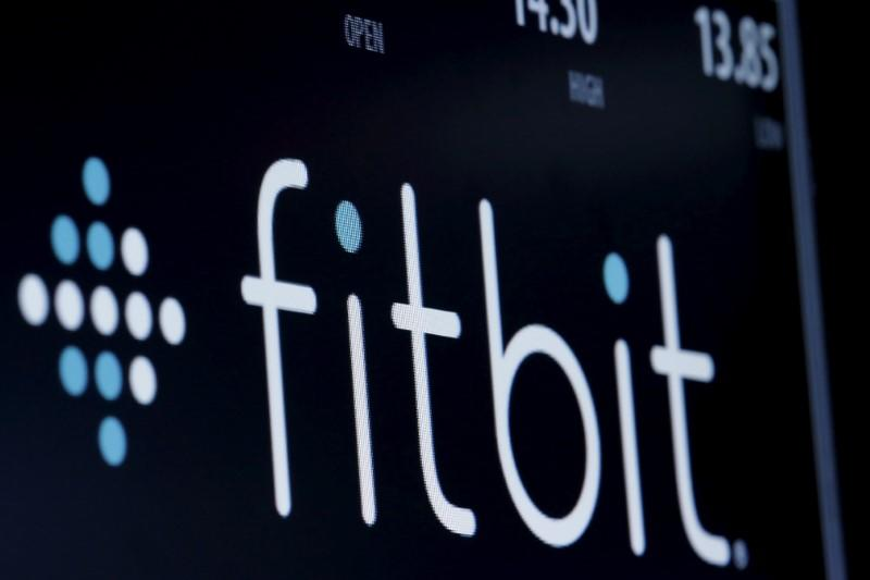 FILE PHOTO - The ticker symbol for Fitbit is displayed at the post where it is traded on the floor of the NYSE