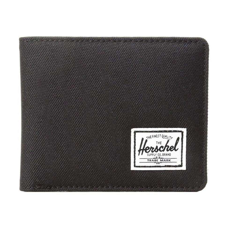 """<p><strong>Herschel</strong></p><p>amazon.com</p><p><strong>$28.33</strong></p><p><a href=""""https://www.amazon.com/Herschel-Supply-Wallet-Synthetic-Leather/dp/B01LZE9I06/ref?tag=syn-yahoo-20&ascsubtag=%5Bartid%7C2089.g.291%5Bsrc%7Cyahoo-us"""" rel=""""nofollow noopener"""" target=""""_blank"""" data-ylk=""""slk:Shop Now"""" class=""""link rapid-noclick-resp"""">Shop Now</a></p><p>Durable and versatile, this Herschel wallet has a currency pouch for cash, slip pockets, and three card slots. Because isn't it time your buddy upgraded his wallet from college? </p>"""