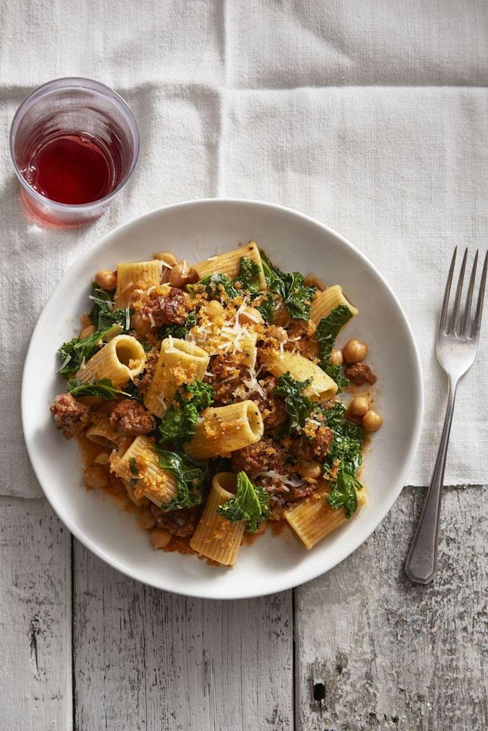 """<p>An updated take on classic bolognese, this rigatoni pairs chorizo and breadcrumbs with shards of creamy manchego cheese. </p><p><a href=""""https://www.goodhousekeeping.com/food-recipes/a46044/chickpea-and-kale-rigatoni-recipe/"""" rel=""""nofollow noopener"""" target=""""_blank"""" data-ylk=""""slk:Get the recipe for Chickpea and Kale Rigatoni With Smoky Bread Crumbs »"""" class=""""link rapid-noclick-resp""""><em>Get the recipe for Chickpea and Kale Rigatoni With Smoky Bread Crumbs »</em></a></p>"""