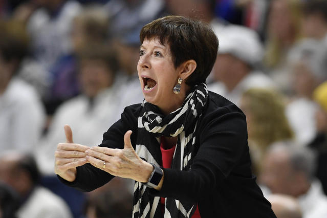FILE - In this Dec. 9, 2019, file photo, Notre Dame head coach Muffet McGraw directs the team in the first half of an NCAA college basketball game against UConn, in Storrs, Conn. McGraw abruptly retired Wednesday, April 22, 2020, stepping down from Notre Dame after a Hall of Fame coaching career that includes two national championships in 33 seasons. (AP Photo/Jessica Hill, File)