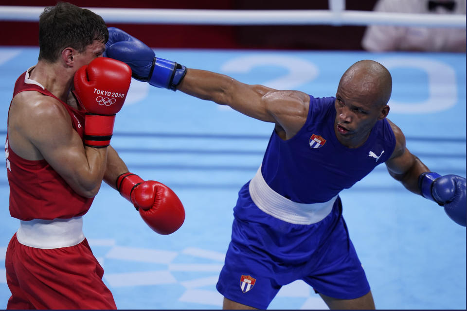 Britain's Pat McCormack, left, exchanges punches with Cuba's Roniel Iglesias during their men's welterweight 69-kg boxing match at the 2020 Summer Olympics, Tuesday, Aug. 3, 2021, in Tokyo, Japan. (AP Photo/Frank Franklin II)