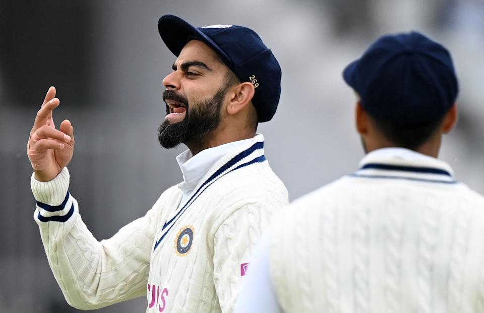 <p>India's captain Virat Kohli (L) gestures to his fielders on the fifth and final day of the second cricket Test match between England and India at Lord's cricket ground in London on August 16, 2021. (Photo by GLYN KIRK/AFP via Getty Images)</p>