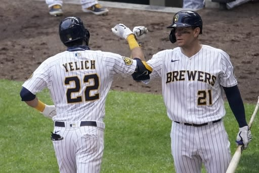 Brewers rally to beat Reds 9-3 for 1st home win