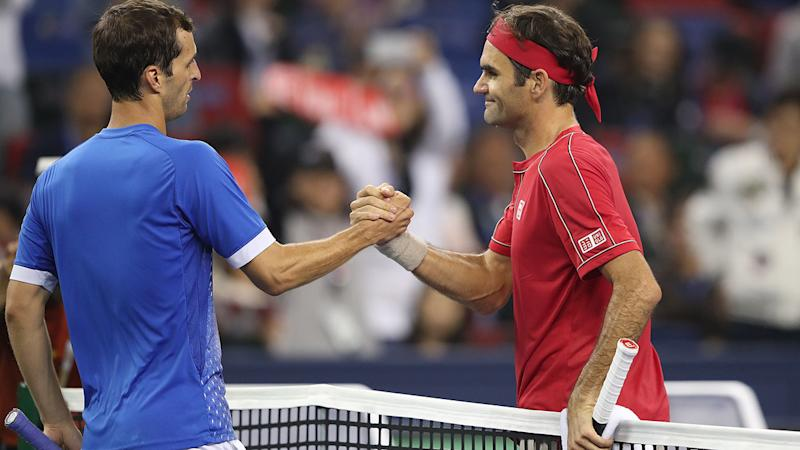 Roger Federer, pictured here shaking hands with Albert Ramos-Vinolas.