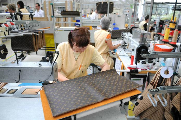 Employees at work in the 20,000-square-metre Louis Vuitton plant in Sioule, France.   Sipa/Shutterstock