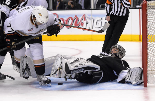 Los Angeles Kings goalie Jonathan Quick, right, falls on a puck as Anaheim Ducks right wing Devante Smith-Pelly defends during the third period in Game 3 of an NHL hockey second-round Stanley Cup playoff series, Thursday, May 8, 2014, in Los Angeles. The Ducks won 3-2. (AP Photo/Mark J. Terrill)
