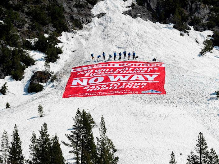 Three members of the far-right group Generation Identity have been jailed for an anti-migrant stunt in the French Alps: Romain Lafabregue/AFP/Getty Images