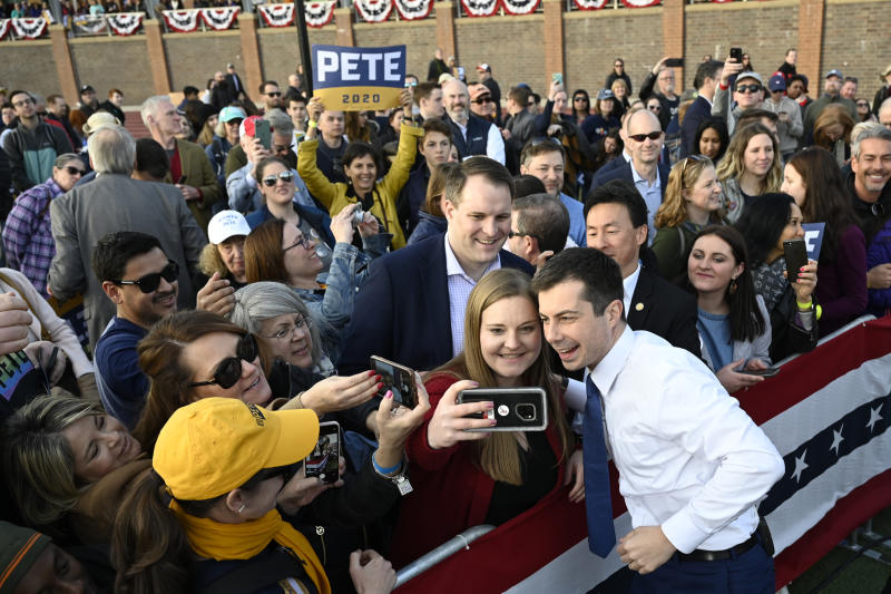 Democratic presidential candidate former South Bend, Ind., Mayor Pete Buttigieg greets the audience during a campaign stop in Arlington, Va., Sunday, Feb. 23, 2020. (AP Photo/Susan Walsh)
