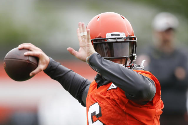 FILE - In this May 22, 2019, file photo, Cleveland Browns' Baker Mayfield throws a pass during an NFL football practice at the team's training facility in Berea, Ohio. It all starts with Mayfield, the former No. 1 overall pick who began last season as Tyrod Taylors backup and finished it breaking Peyton Mannings league rookie record for touchdown passes despite playing in only 14 games. (AP Photo/Ron Schwane, File)