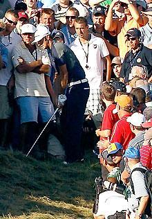 Dustin Johnson prepares to play his second shot on the 18th hole during the final round