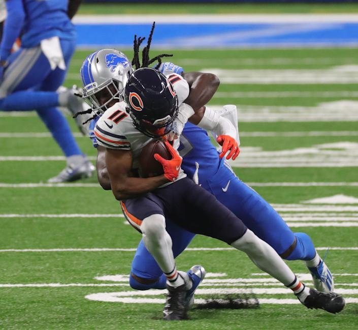Detroit Lions cornerback Desmond Trufant (23) tackles Chicago Bears wide receiver Darnell Mooney (11) during third quarter action at Ford Field Sunday, September 13, 2020.