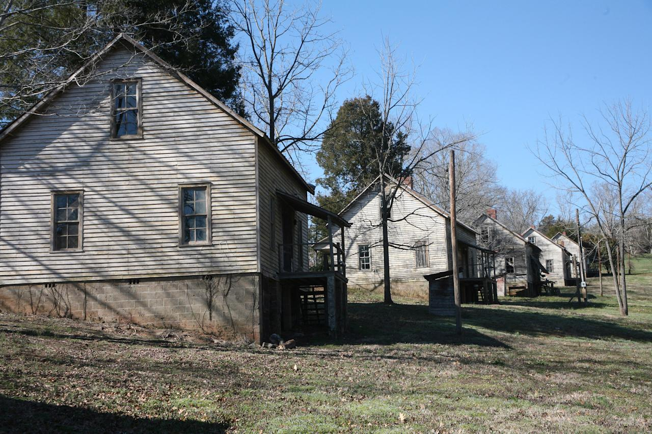 "This undated image provided by VisitNC.com shows the abandoned Henry River Mill Village in Hildebran, N.C., where scenes from ""The Hunger Games"" were shot. The house on the left was outfitted as the Everdeens' home in the Seam, part of District 12 in fictional Panem. (AP Photo/VisitNC.com, Margo Metzger)"