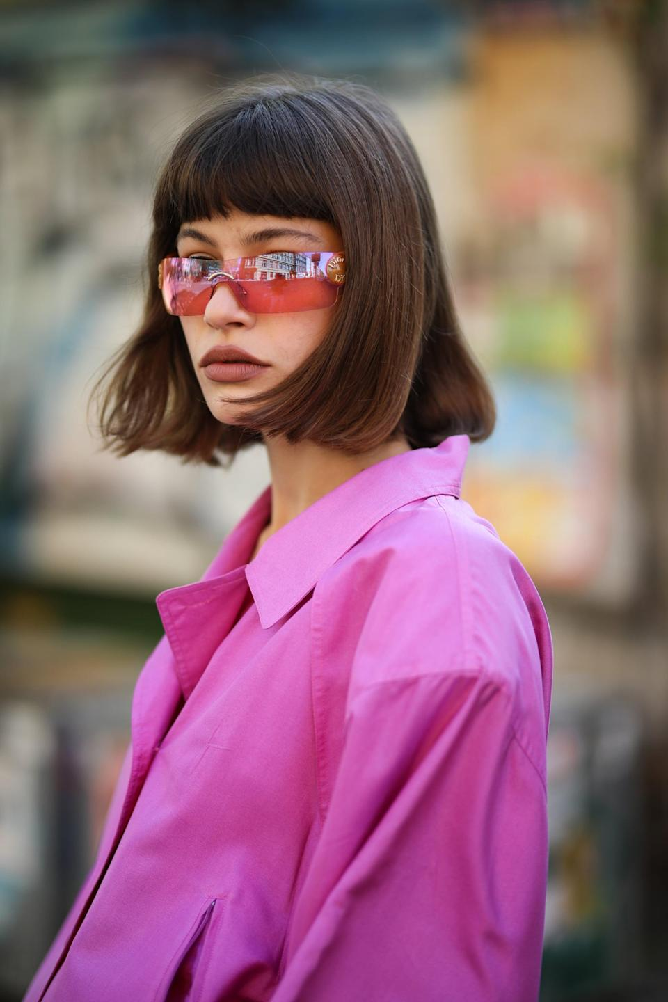 """<p>Blunt bangs are typically cut straight across from the outside corner of each eye. """"You can also make [fringe] heavy or soft,"""" <a href=""""https://johnbarrett.com/"""" class=""""link rapid-noclick-resp"""" rel=""""nofollow noopener"""" target=""""_blank"""" data-ylk=""""slk:John Barrett"""">John Barrett</a> stylist Dhiran Mistry explained. """"You can make it softer by cutting more into it and using a smaller section, so it's less hair falling in the face.""""</p> <p>Because the horizontal line with these bangs tends to span the entire forehead, double check with your stylist that the cut will accentuate - not shorten - your face shape.</p>"""