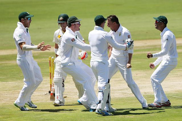 CENTURION, SOUTH AFRICA - FEBRUARY 12: Dale Steyn of South Africa celebrates with teammates after getting the wicket of David Warner of Australia (L) during day one of the First Test match between South Africa and Australia on February 12, 2014 in Centurion, South Africa. (Photo by Morne de Klerk/Getty Images)