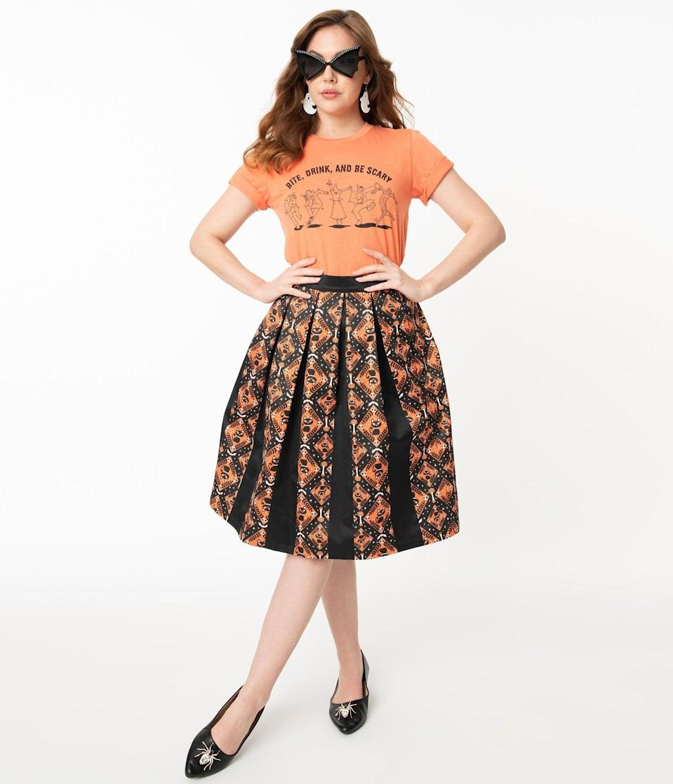 <p>You'll look wicked fashionable in this <span>Unique Vintage Black and Orange Halloween Print Jayne Swing Skirt</span> ($68). </p>