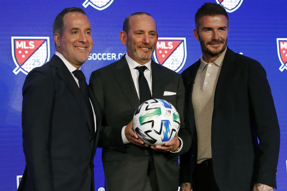 Inter Miami CF co-owners Jorge Mas, left, and David Beckham, right, pose for photos with Major League Soccer Commissioner Don Garber during the Major League Soccer 25th Season kickoff event, New York, Wednesday, Feb. 26, 2020. (AP Photo/Richard Drew)