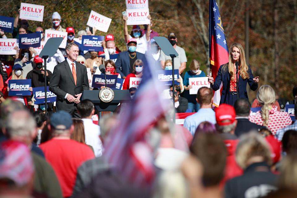 Sen. Kelly Loeffler (R-GA) speaks to supporters at the Stop the Steal the Defend the Majority Rally alongside Sen. David Perdue (R-GA) on Friday, Nov. 20, 2020 in Canton, GA. (Jason Armond / Los Angeles Times via Getty Images)