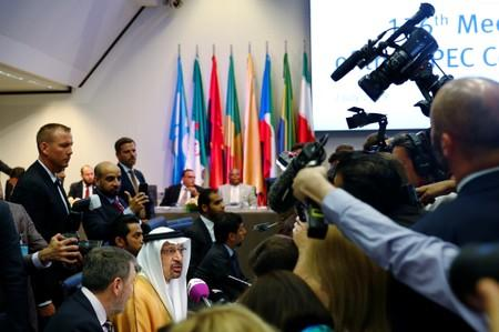 Saudi Arabia's Oil Minister Khalid Al-Falih talks to journalists at the beginning of an OPEC meeting in Vienna