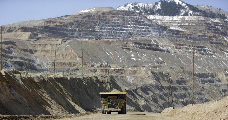 A mining haul truck carries rock at the Kennecott Utah Copper Bingham Canyon Mine during a media tour Thursday, April 25, 2013, following a April 10, landslide, in Bingham Canyon, Utah. The chief of Kennecott Utah Copper guided media to the rim of Bingham Canyon Mine for a view of a massive landslide that stopped operations April 10 when 165 million tons of rock and dirt ran down a wall of the open pit. (AP Photo/Rick Bowmer)