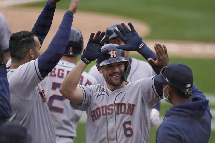 Houston Astros' Chas McCormick (6) is congratulated by teammates after hitting a three-run home run against the Oakland Athletics during the sixth inning of a baseball game in Oakland, Calif., Sunday, April 4, 2021. (AP Photo/Jeff Chiu)