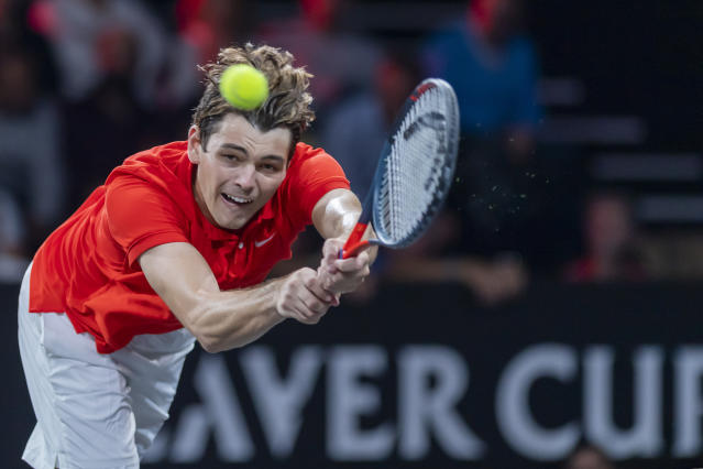 Team World's Taylor Fritz returns a ball to Team Europe's Dominic Thiem during their match at the Laver Cup tennis event in Geneva, Sunday, Sept. 22, 2019. (Martial Trezzini/Keystone via AP)