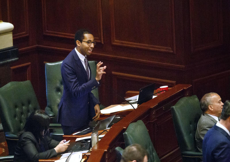 FILE - In this May, 31, 2017, file photo, Rep. Christian Mitchell, D-Chicago, speaks on the House floor at the Capitol in Springfield, Ill. A unique provision in Illinois' newly minted law legalizing marijuana allows expungement of criminal records for anyone convicted of purchase or possession of one ounce (30 grams) or less of marijuana, a group of nearly 800,000 people. (Rich Saal/The State Journal-Register via AP, File)