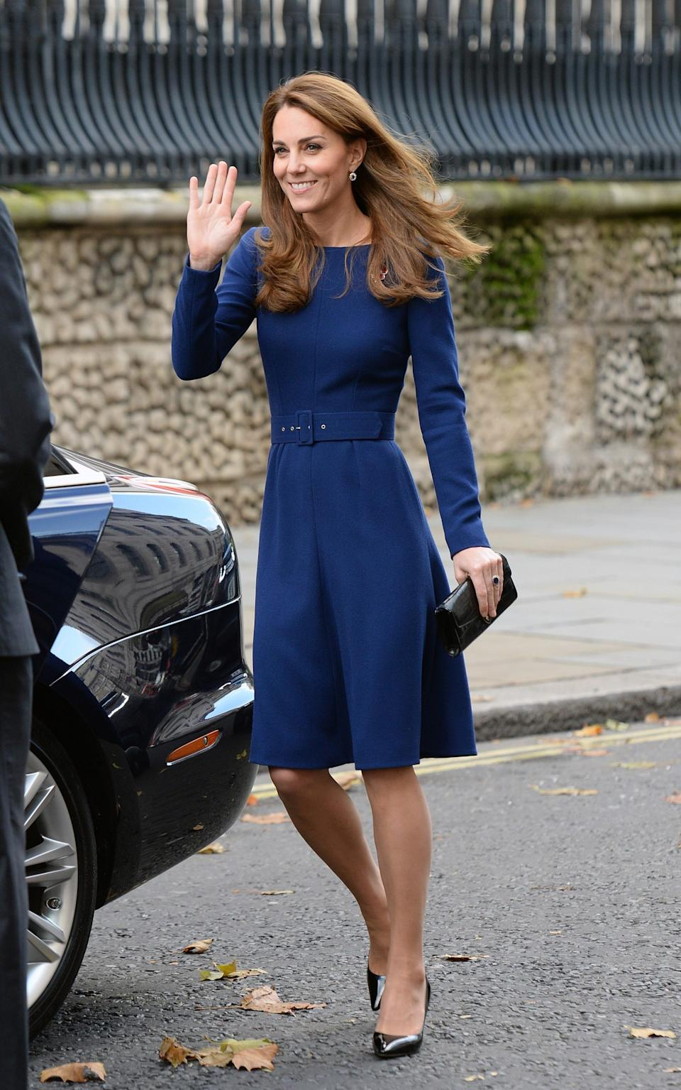 The Duchess wears another of her go-to plain, tailored dresses - Getty